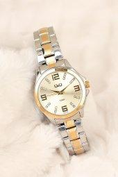 Q&q Marka Silver Gold Renk Metal Kordonlu Taşlı Şık Kasa 2 Yıl Garantili Bayan Kol Saati